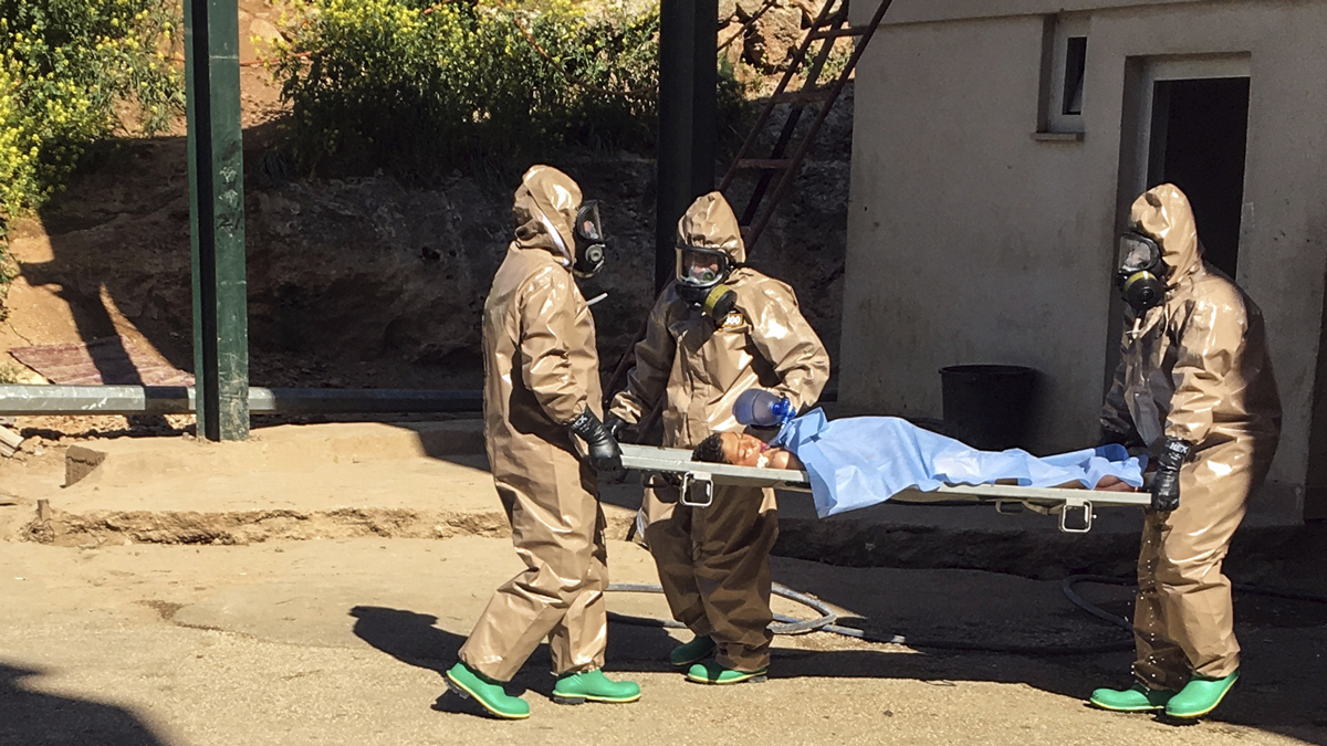 In this photo taken on Tuesday, April 4, 2017 and made available Wednesday, April 5, Turkish experts carry a victim of alleged chemical weapons attacks in Syrian city of Idlib, at a local hospital in Reyhanli, Hatay, Turkey. A suspected chemical attack in a town in Syria's rebel-held northern Idlib province killed dozens of people on Tuesday, opposition activists said, describing the attack as among the worst in the country's six-year civil war.
