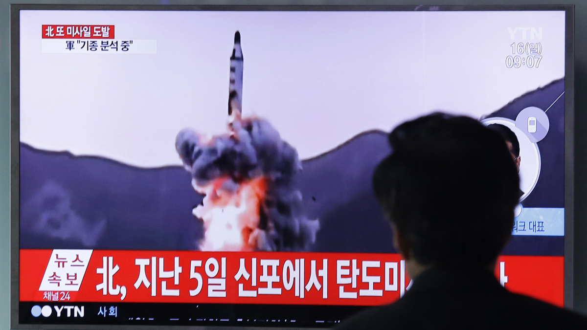 A man watches a TV showing file footage of a North Korean ballistic missile at Seoul Railway Station in Seoul, South Korea, Sunday, April 16, 2017. A North Korean missile exploded during launch Sunday from the country's east coast, U.S. and South Korean officials said, a high-profile failure that comes as a powerful U.S. aircraft carrier approaches the Korean Peninsula in a show of force. The letters on the top read