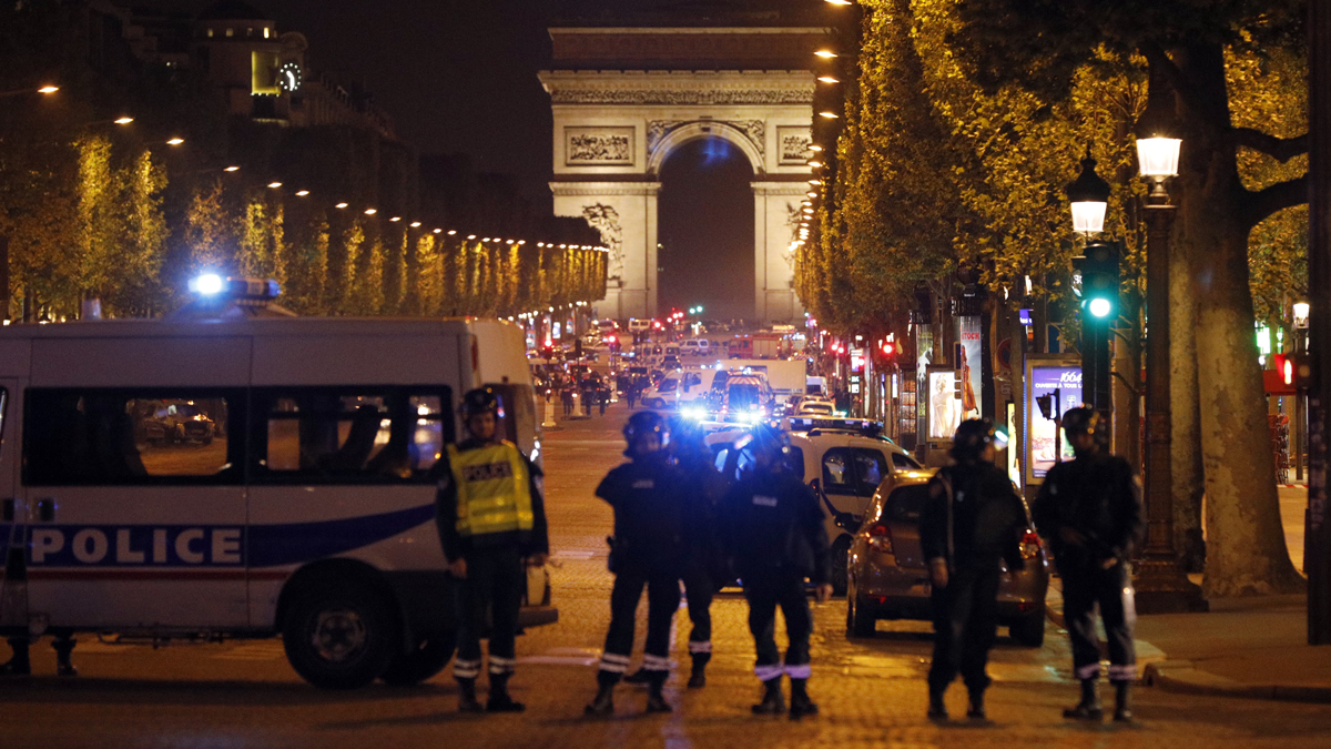 Police seal off the Champs-Elysees avenue in Paris, France, after a shooting in which a police officer was killed along with an attacker, Thursday, April 20, 2017. Three police officers were shot in total, along with a tourist, on the famed shopping boulevard.