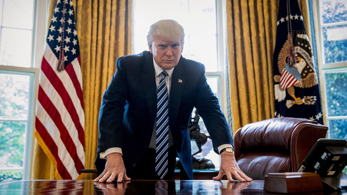 President Donald Trump poses for a portrait in the Oval Office in Washington, Friday, April 21, 2017. With his tweets and his bravado, Trump is putting his mark on the presidency in his first 100 days in office.