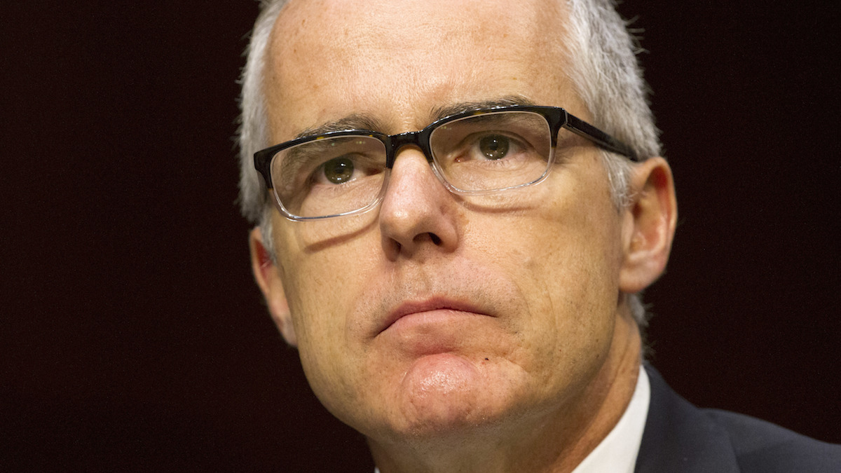 In this file photo, then-acting FBI Director Andrew McCabe, listens as Director of National Intelligence Dan Coats, testifies at a Senate Intelligence Committee hearing, on Capitol Hill in Washington, Thursday, May 11, 2017.