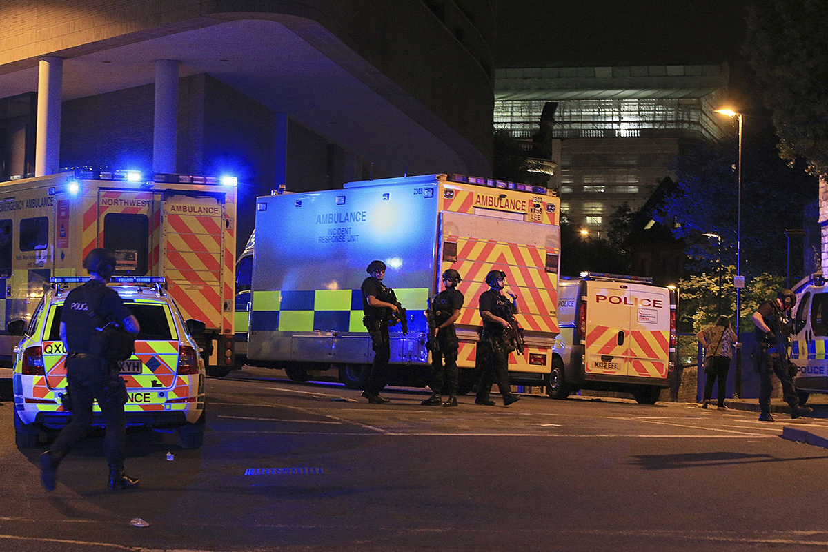 Armed police work at Manchester Arena after reports of an explosion at the venue during an Ariana Grande gig in Manchester, England Monday, May 22, 2017. Several people have died following reports of an explosion Monday night at an Ariana Grande concert in northern England, police said. A representative said the singer was not injured.
