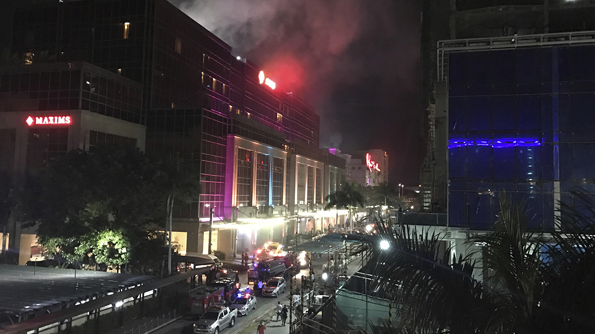 Smoke rises from the Resorts World Manila complex early Friday, June 2, 2017, in Manila, Philippines. Gunshots and explosions rang out early Friday at a mall, casino and hotel complex near Manila's international airport in the Philippine capital, sparking a security alarm amid an ongoing Muslim militant siege in the country's south.