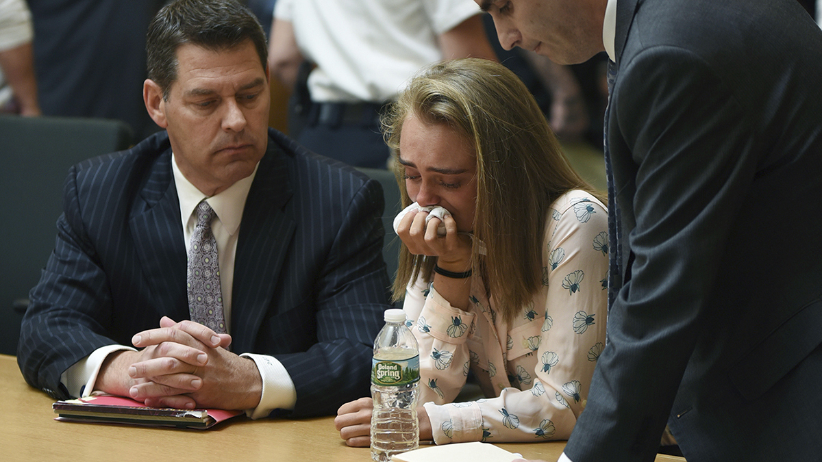 Michelle Carter cries while flanked by defense attorneys Joseph Cataldo, left, and Cory Madera, after being found guilty of involuntary manslaughter in the suicide of Conrad Roy III, Friday, June 16, 2017, in Bristol Juvenile Court in Taunton, Massachusetts.