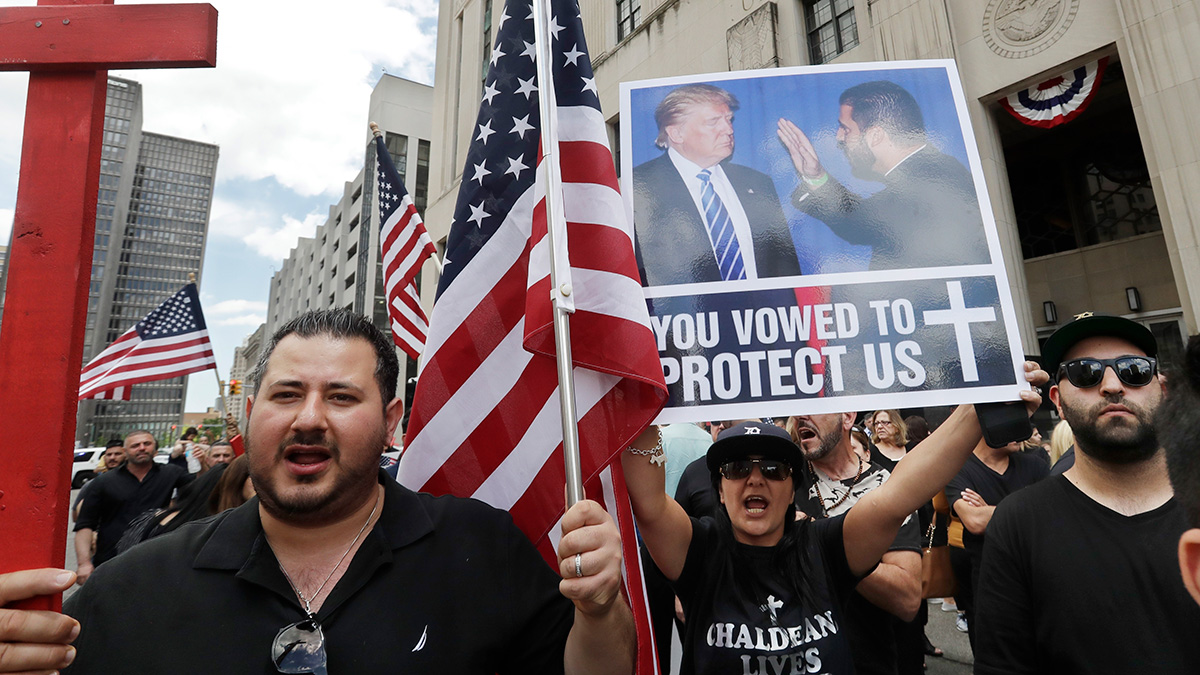 This June 21, 2017, file photo shows Iraqis and supporters rallying outside the Theodore Levin United States Courthouse in Detroit. A federal judge in Detroit on Monday blocked the deportation of more than 1,400 Iraqi nationals.