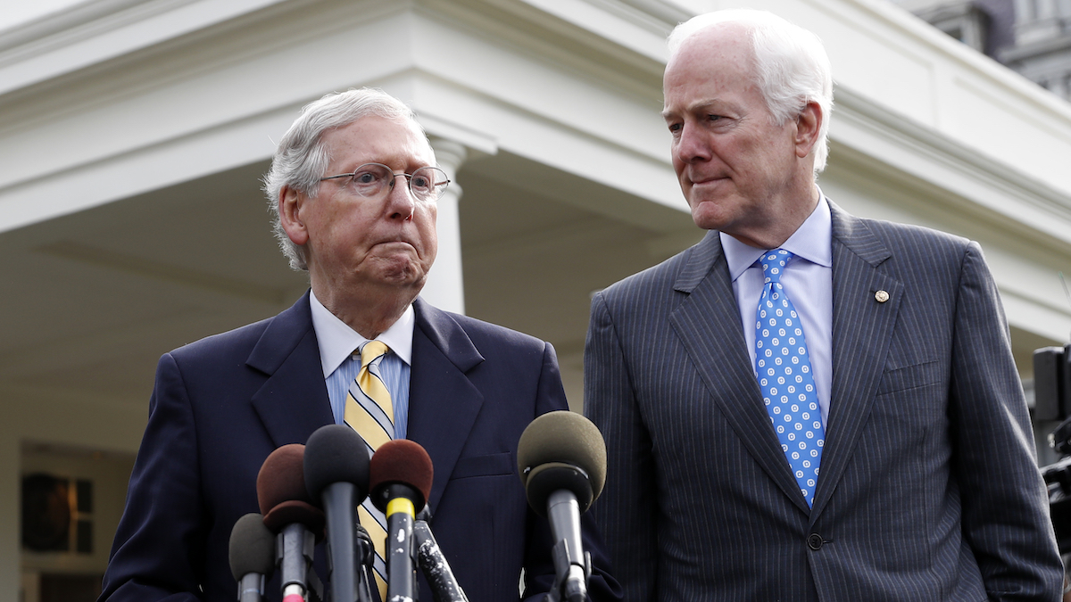 Senate Majority Leader Mitch McConnell of Ky., left, and Senate Majority Whip Sen. John Cornyn, R-Texas, speak with the media after they and other Senate Republicans had a meeting with President Donald Trump at the White House, June 27, 2017, in Washington.