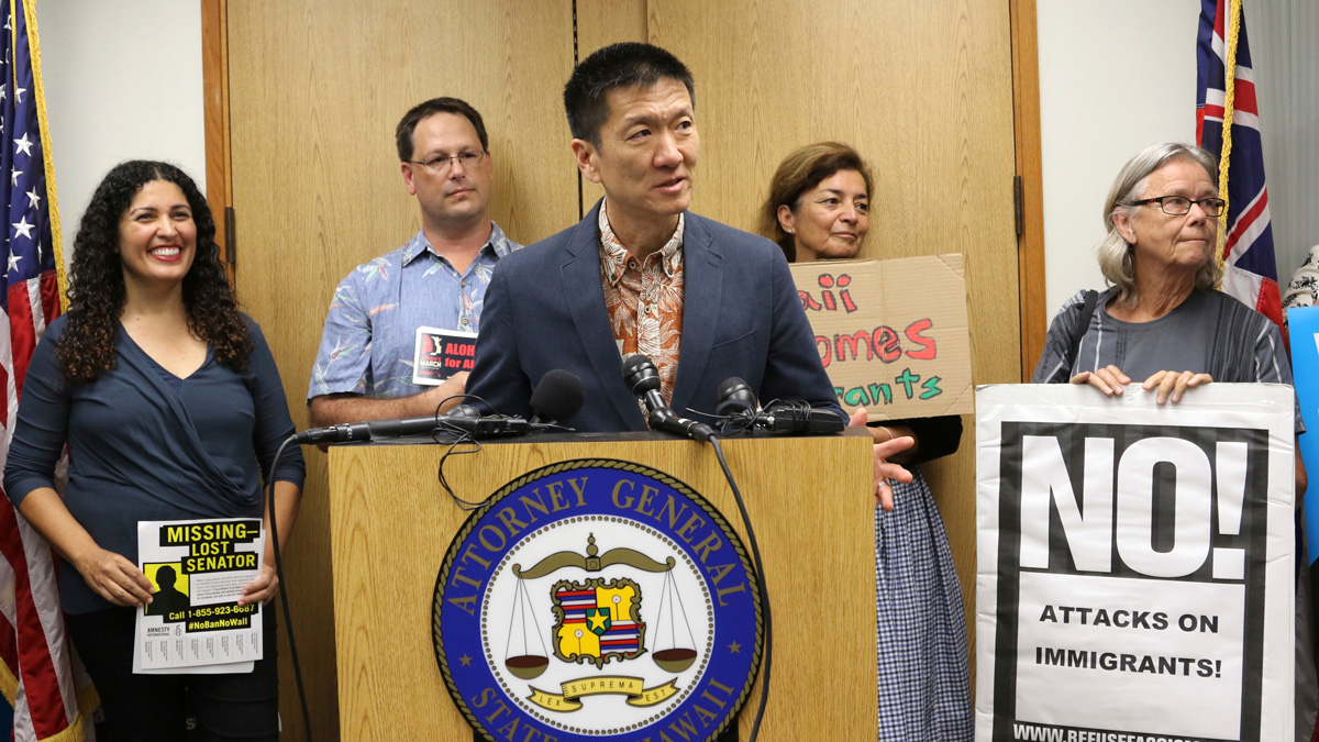 Hawaii Attorney General Douglas Chin speaks at a news conference about President Donald Trump's travel ban on June 30, 2017, in Honolulu.