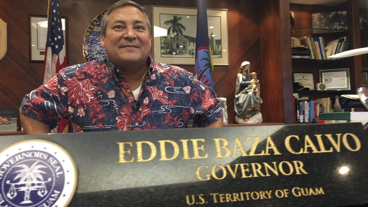 Guam Gov. Guam Eddie Baza Calvo speaks to the media in his office in Adelup, Guam, Friday, Aug. 11, 2017. The small U.S. territory of Guam has become a focal point after North Korea's army threatened to use ballistic missiles to create an