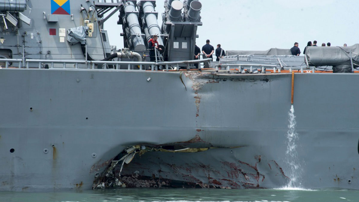 FILE - In this Aug. 21, 2017, file photo, damage is visible as the guided-missile destroyer USS John S. McCain steers towards Changi naval base in Singapore following a collision with the merchant vessel Alnic MC. A number of sailors are missing. (Mass Communication Specialist 2nd Class Joshua Fulton/U.S. Navy photo via AP, File)