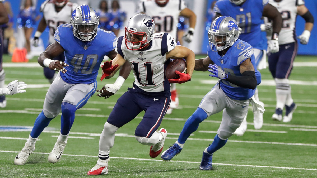 New England Patriots wide receiver Julian Edelman (11) breaks downfield as Detroit Lions linebacker Jarrad Davis (40) and cornerback Darius Slay (23) give chase during the first half of an NFL preseason football game, Friday, Aug. 25, 2017, in Detroit.