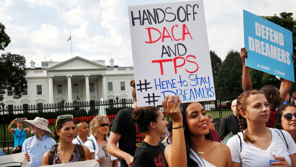 Yurexi Quinones, 24, of Manassas, Virginia, a college student who is studying social work and a recipient of Deferred Action for Childhood Arrivals, known as DACA, rallies next to Ana Rice, 18, of Manassas, Virginia, far right, in support of DACA, outside of the White House in Washington, Tuesday, Sept. 5, 2017.