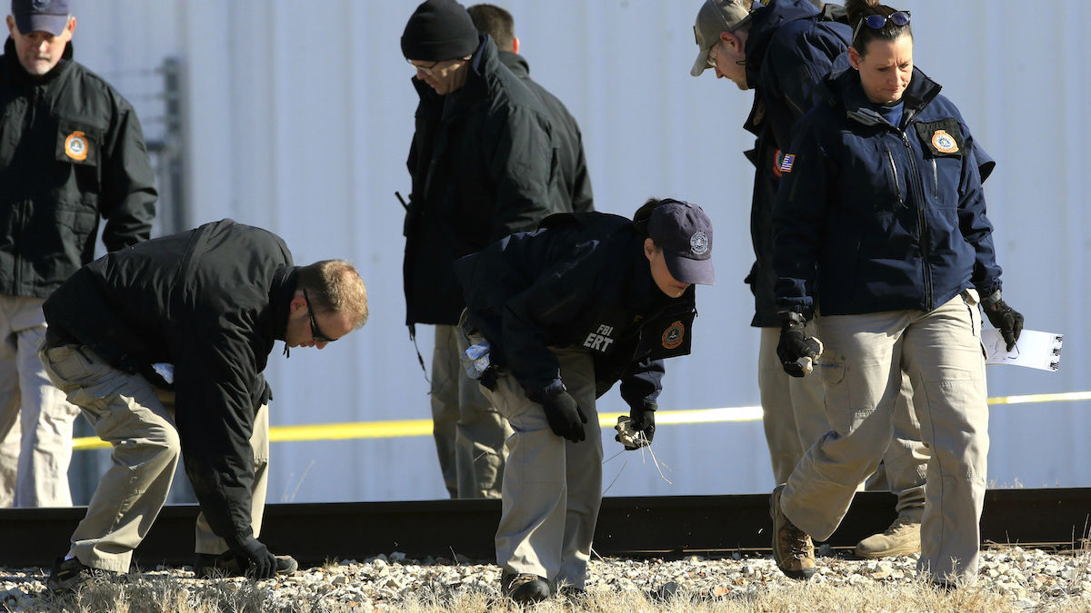 FBI agents look for evidence outside Excel Industries in Hesston, Kan., Friday, Feb. 26, 2016. The deadly assault on Thursday at the lawnmower parts plant in the small town of Hesston ended when a police officer killed the gunman during a shootout.   (AP Photo/Orlin Wagner)