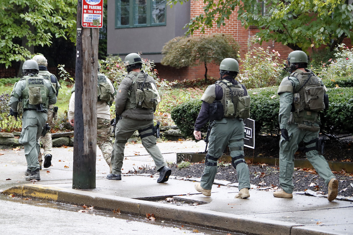 A SWAT team arrives at the Tree of Life Synagogue where a shooter opened fire injuring multiple people, Saturday, Oct. 27, 2018.