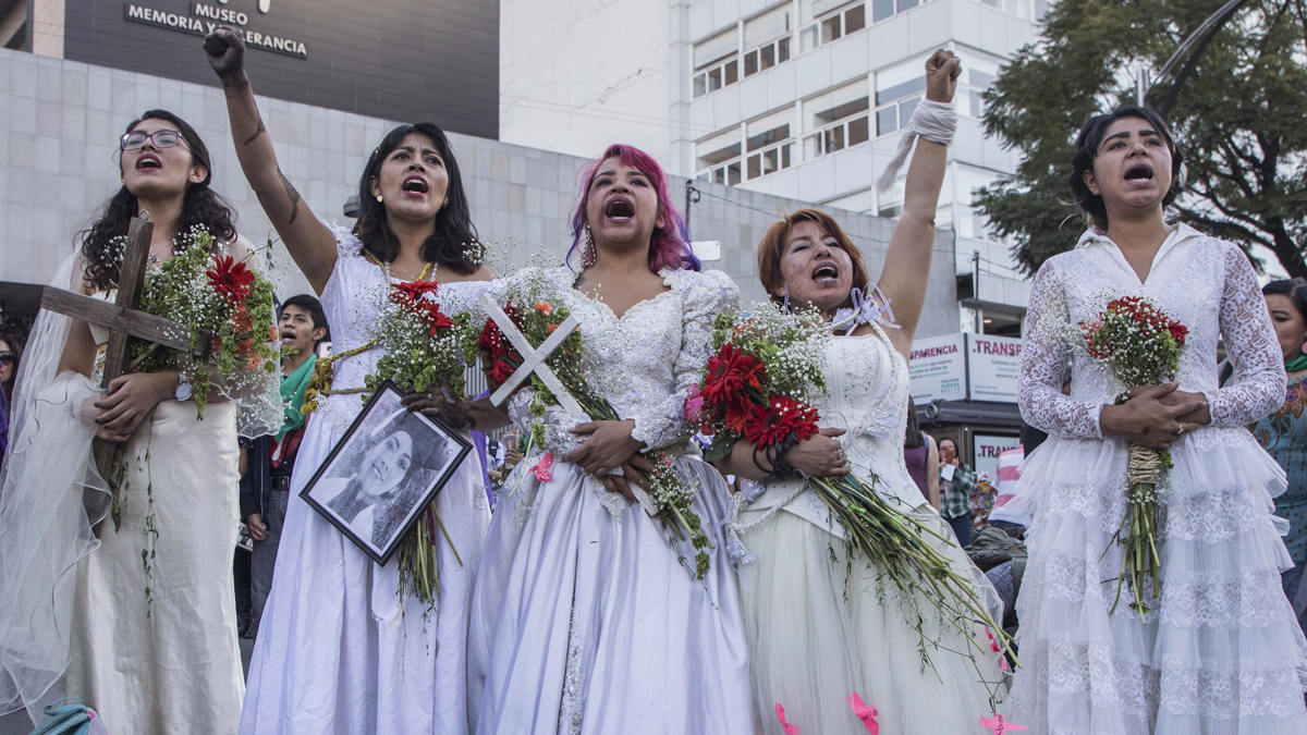 Women dressed as brides attend a march marking the International Day for the elimination of violence against women in Mexico City, Sunday, Nov. 25, 2018.