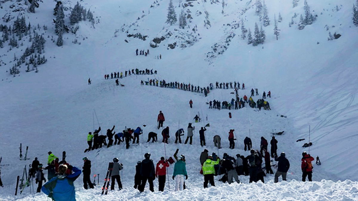 People search for victims after an avalanche buried multiple people near the highest peak of Taos Ski Valley, one of the biggest resorts in New Mexico, Jan. 17, 2019. The avalanche rushed down the mountainside of the New Mexico ski resort on Thursday, injuring at least a few people who were pulled from the snow after a roughly 20-minute rescue effort, a resort spokesman said.