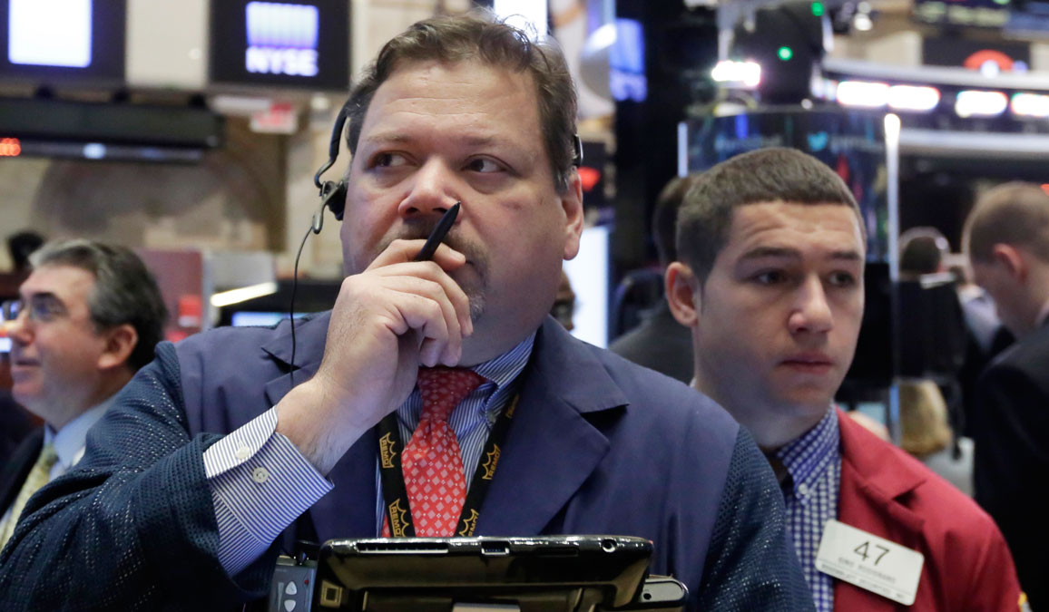 In this file photo, trader John Santiago, foreground left, works on the floor of the New York Stock Exchange, Monday, Feb. 1, 2016. Another steep drop in oil and natural gas prices is pulling the stock market lower in early trading. (AP Photo/Richard Drew)