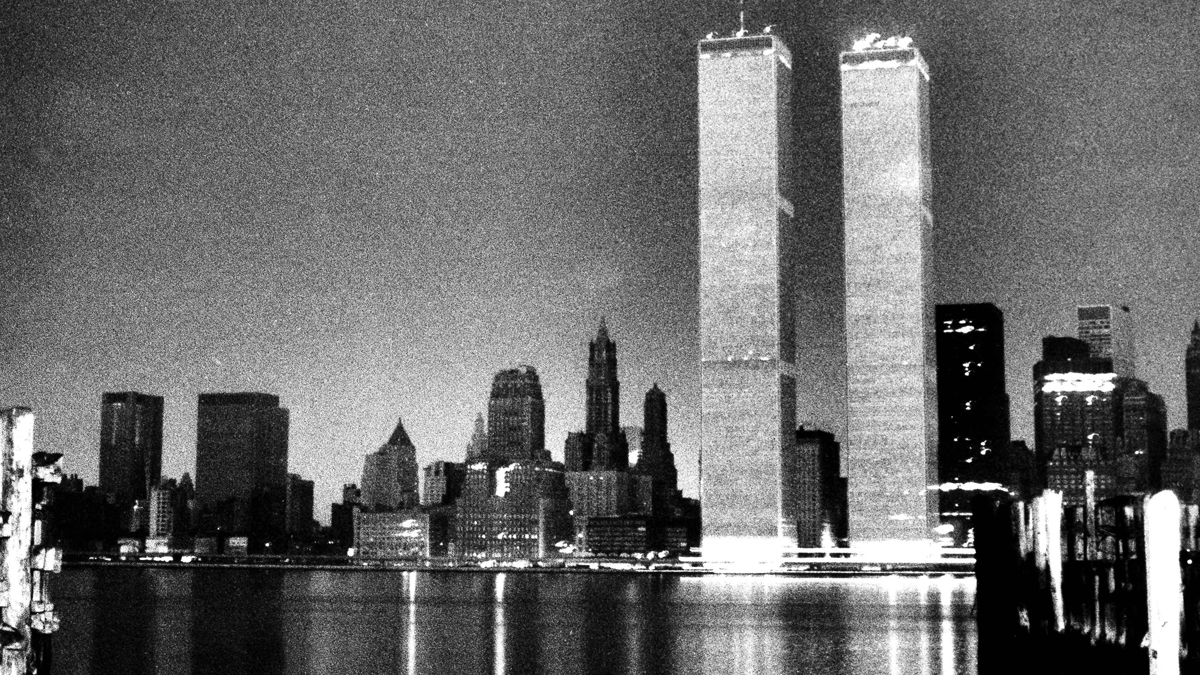 Light-colored facing on the World Trade Center makes it stand out from the blackened New York City skyline after a power failure struck the city, July 13, 1977. Lightning striking a power station is blamed for the blackout. (AP Photo/LM)