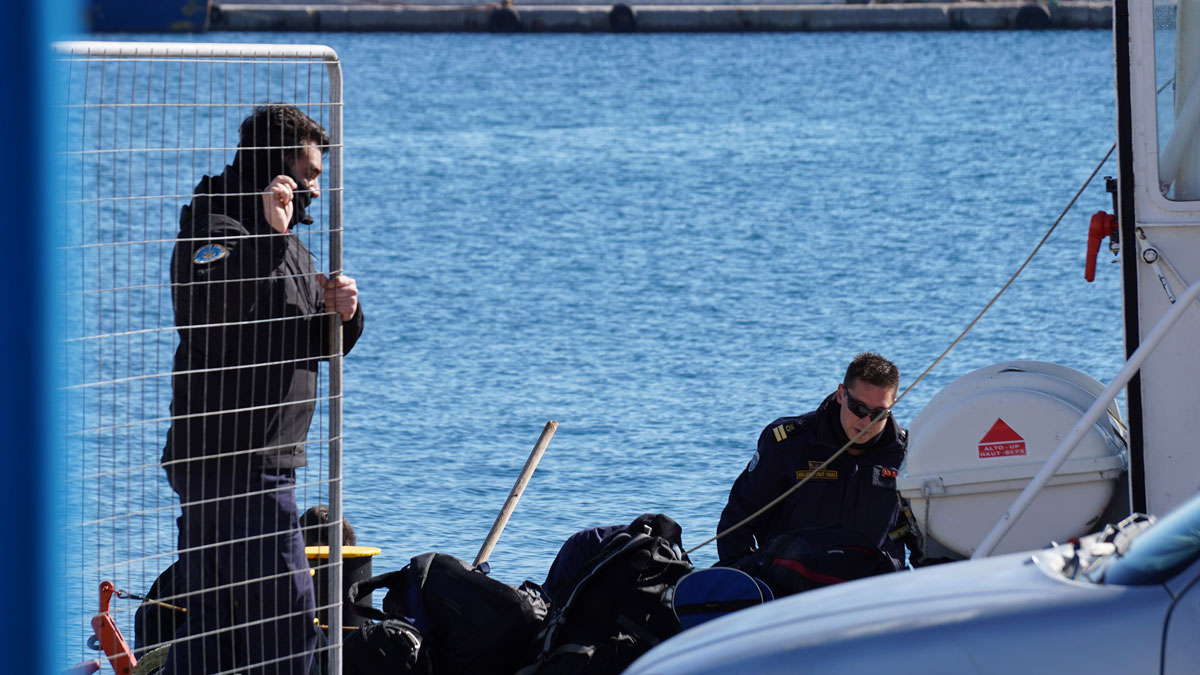 Greek Coast guard officers prepare for a rescue mission at the port of Kalymnos island on Friday, Jan. 22, 2016. A wooden sailboat carrying an undetermined number of people sank off the islet of Kalolimnos near the Greek southeastern island of Kalymnos.