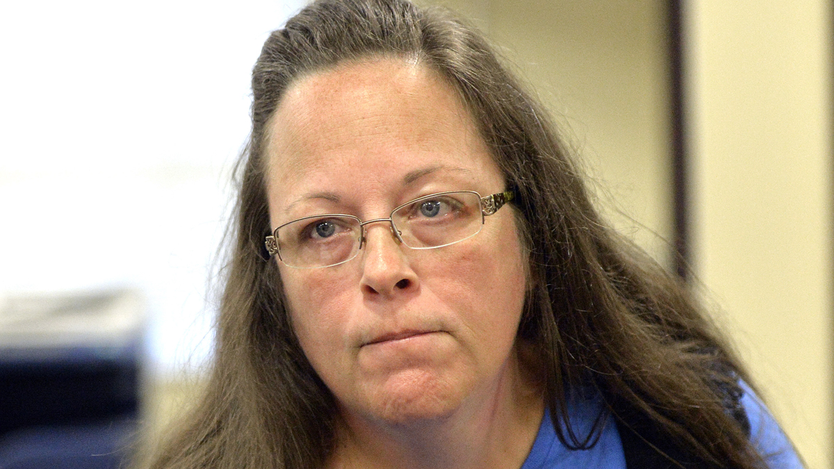Rowan County Clerk Kim Davis listens to a customer following her office's refusal to issue marriage licenses at the Rowan County Courthouse in Morehead, Ky., Tuesday, Sept. 1, 2015. Although her appeal to the U.S. Supreme Court was denied, Davis still refuses to issue marriage licenses.