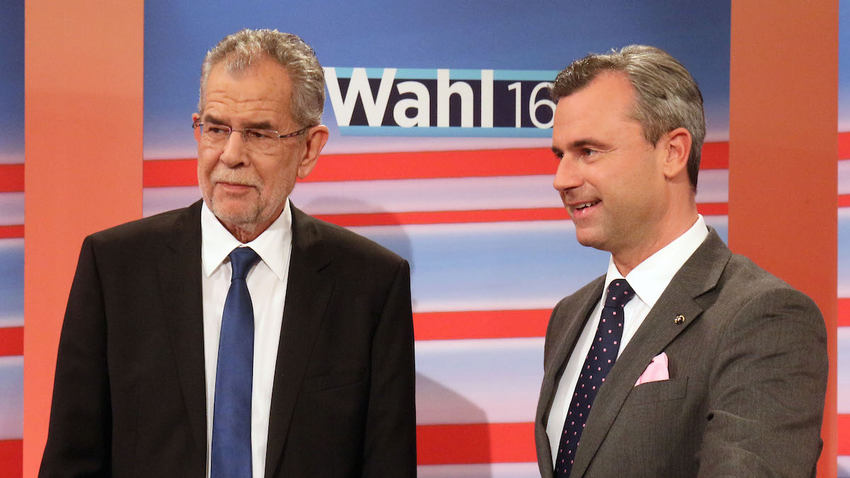Alexander Van der Bellen candidate of the Austrian Greens, left, and Norbert Hofer, candidate for president of Austria's Freedom Party, FPOE, wait for the release of the election results during the Austria presidential elections in Vienna, Austria, May 22, 2016. Nearly final results for Austria's presidential election Sunday showed a right-wing politician neck-to-neck race with a challenger whose views stand in direct opposition to his rival's anti-immigrant and Eurosceptic message.