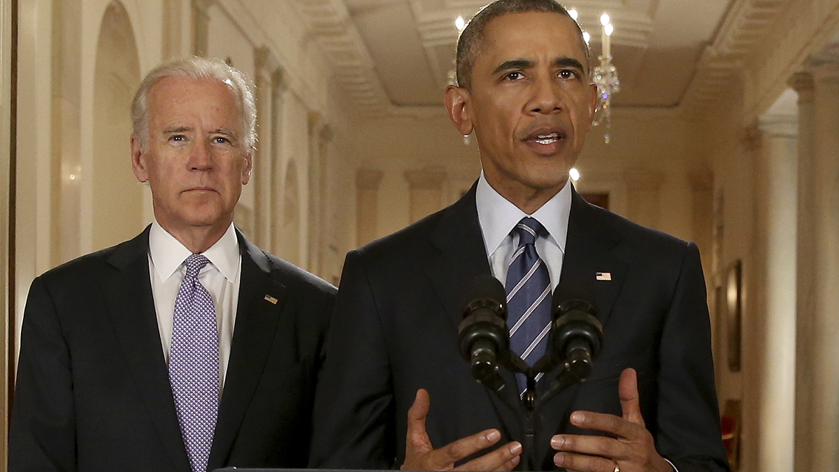 President Barack Obama, standing with Vice President Joe Biden, delivers remarks in the East Room of the White House in Washington, Tuesday, July 14, 2015, after an Iran nuclear deal is reached.