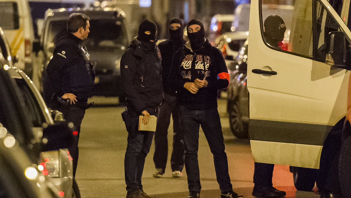 Police investigate an area where terror suspect Mohamed Abrini was arrested in Brussels on Friday April 8, 2016. The federal prosecutor's office confirmed a sixth suspect believed to be connected to the attacks in Brussels was arrested in a new raid in the suburb of Etterbeek.