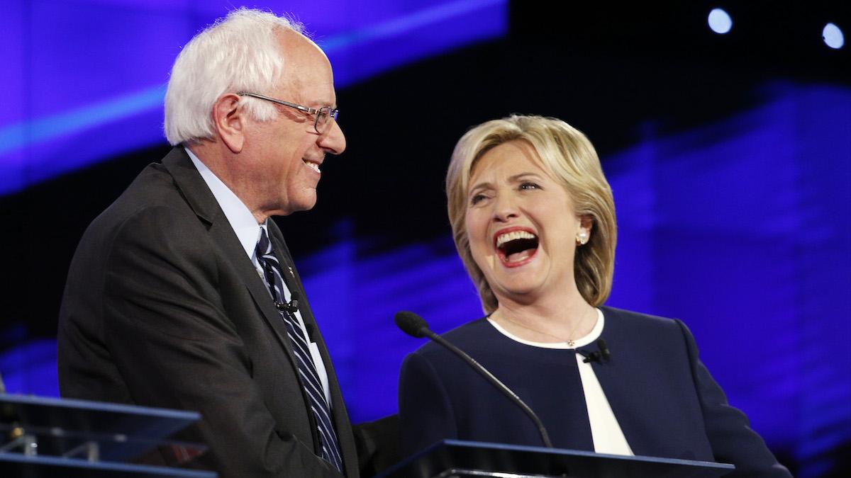 Sen. Bernie Sanders, of Vermont, left, and Hillary Rodham Clinton laugh during the CNN Democratic presidential debate Tuesday, Oct. 13, 2015, in Las Vegas.