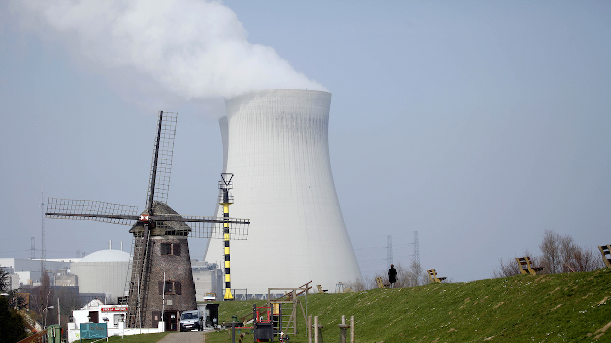 FILE - In this March 15, 2011 file photo, a nuclear power station cooling tower is seen next to a historical windmill in Doel, Belgium.