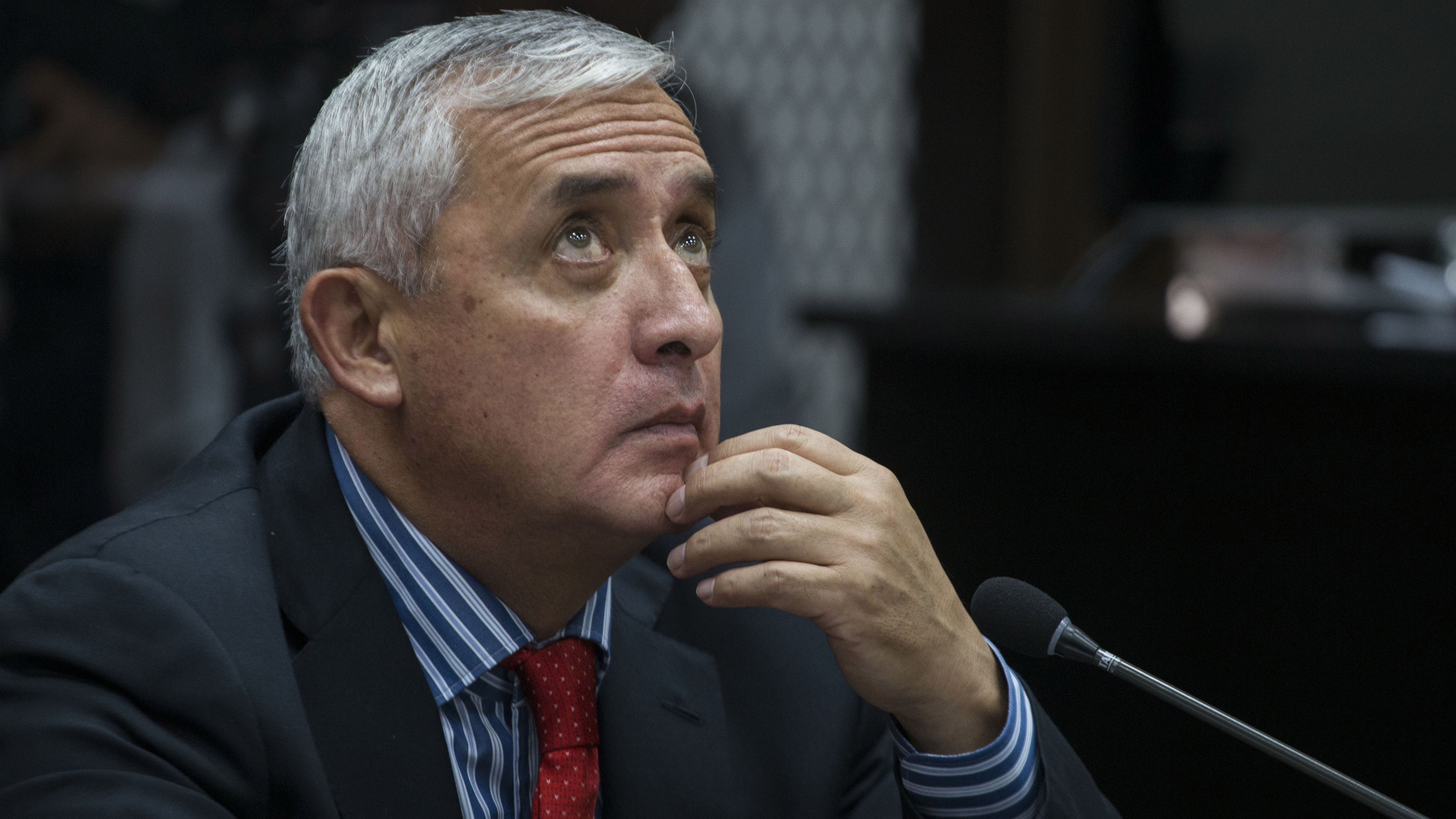 Guatemala's former president Otto Perez Molina sits in court to face corruption charges in Guatemala City, Thursday, Sept. 3, 2015. Perez Molina resigned late Wednesday after a judge issued an order for this detention, accused of leading a customs fraud ring.