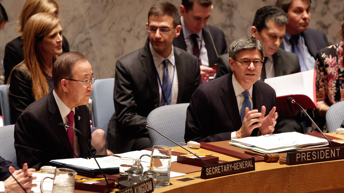 U.S. Treasury Secretary Jacob Lew, right, addresses the United Nations Security Council, as U.N. Secretary General Ban Ki-moon, left, and U.S. U.N Ambassador Samantha Power, upper left, listen, Thursday, Dec. 17, 2015. Finance ministers from the 15 nations on the U.N. Security Council are meeting, to adopt a resolution aimed at disrupting the outside revenue that the Islamic State extremist group gets from selling oil and antiquities, from ransom payments and other criminal activities.