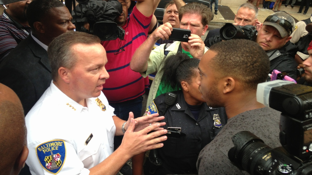 Baltimore Police Commissioner Kevin Davis, left, talks to activist Kwame Rose during a protest at the Baltimore courthouse on Thursday, Sept. 10, 2015, shortly before a judge ruled the trials for six police officers charged in the arrest and death of Freddie Gray will stay in the city. Protesters called for keeping the trials of the officers in Baltimore. (AP Photo/Brian Witte)