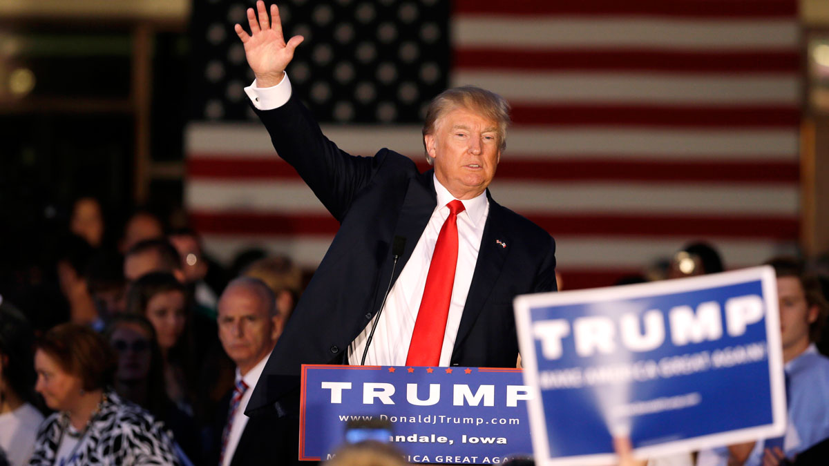 Republican presidential candidate, businessman Donald Trump waves at the end of a rally at Urbandale High School, Saturday, Sept. 19, 2015, in Urbandale, Iowa.