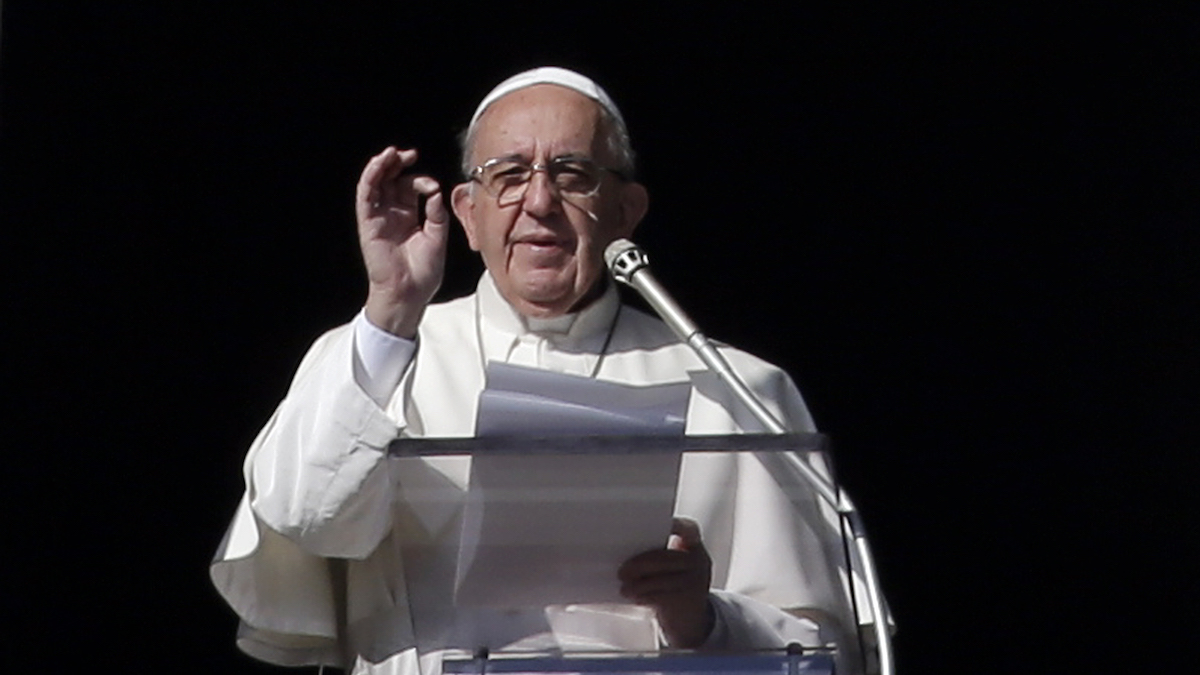Pope Francis recites the Angelus noon prayer in St. Peter's Square at the Vatican, Sunday, Dec. 20, 2015.