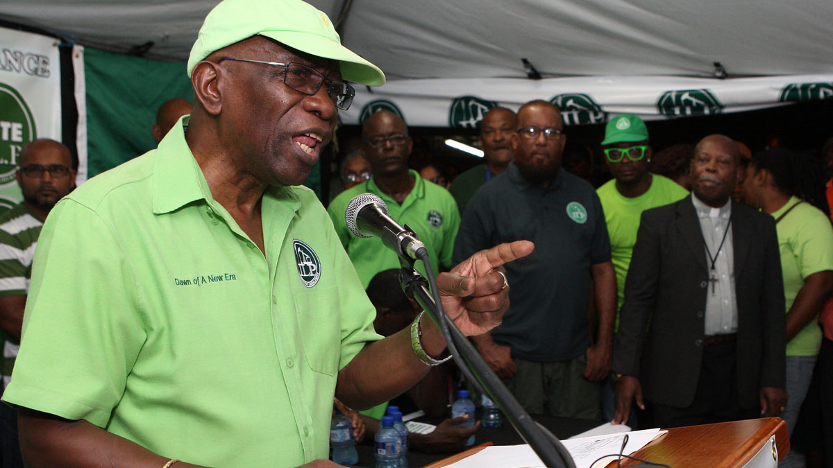 Former FIFA vice president Jack Warner speaks at a political rally in Marabella, Trinidad and Tobago, Wednesday, June 3, 2015. Warner made a televised address Wednesday night, saying he will prove a link between soccer's governing body and his nation's elections in 2010. Warner also said in the address, which was a paid political advertisement, that