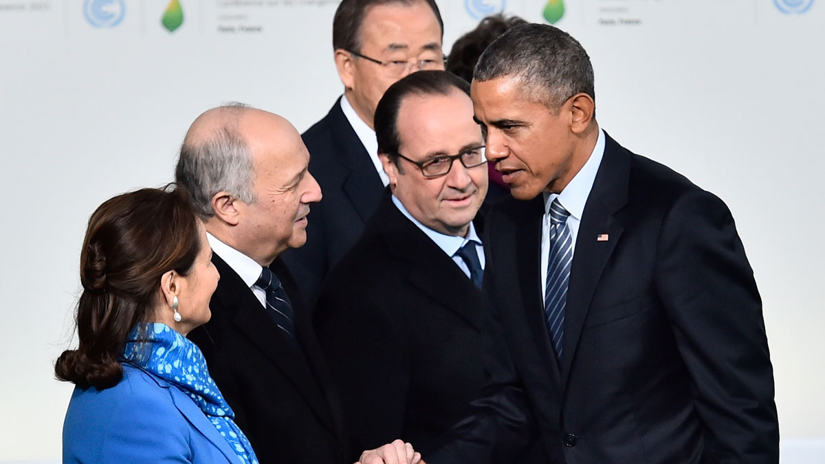 U.S. President Barack Obama shakes hands with French Foreign Affairs Minister Laurent Fabius as Segolene Royal, Minister for Ecology, Sustainable Development and Energy, left, French President Francois Hollande, centre, and United Nations Secretary General Ban Ki-moon, rear, look on as he arrives for the COP21, United Nations Climate Change Conference, in Le Bourget, outside Paris, Monday, Nov. 30, 2015.
