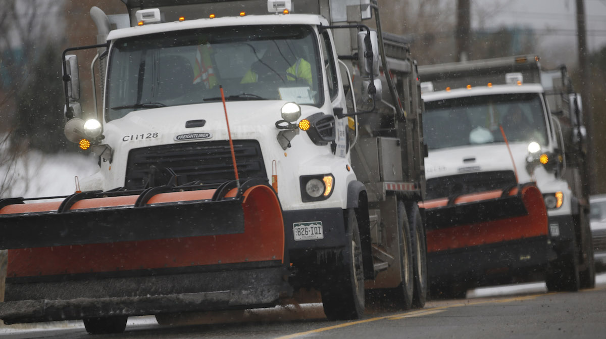City of Denver road trucks spread deicer on the roads late Thursday, Nov. 26, 2015, in northeast Denver. A storm dropping freezing rain and light snow has enveloped the intermountain West on Thanksgiving Day and forecasters predict the cold weather will linger into the weekend ahead.