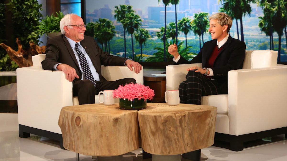 In this photo released by Warner Bros., talk show host Ellen DeGeneres, right, speaks with Democratic presidential candidate Sen. Bernie Sanders, of Vermont, during a taping of