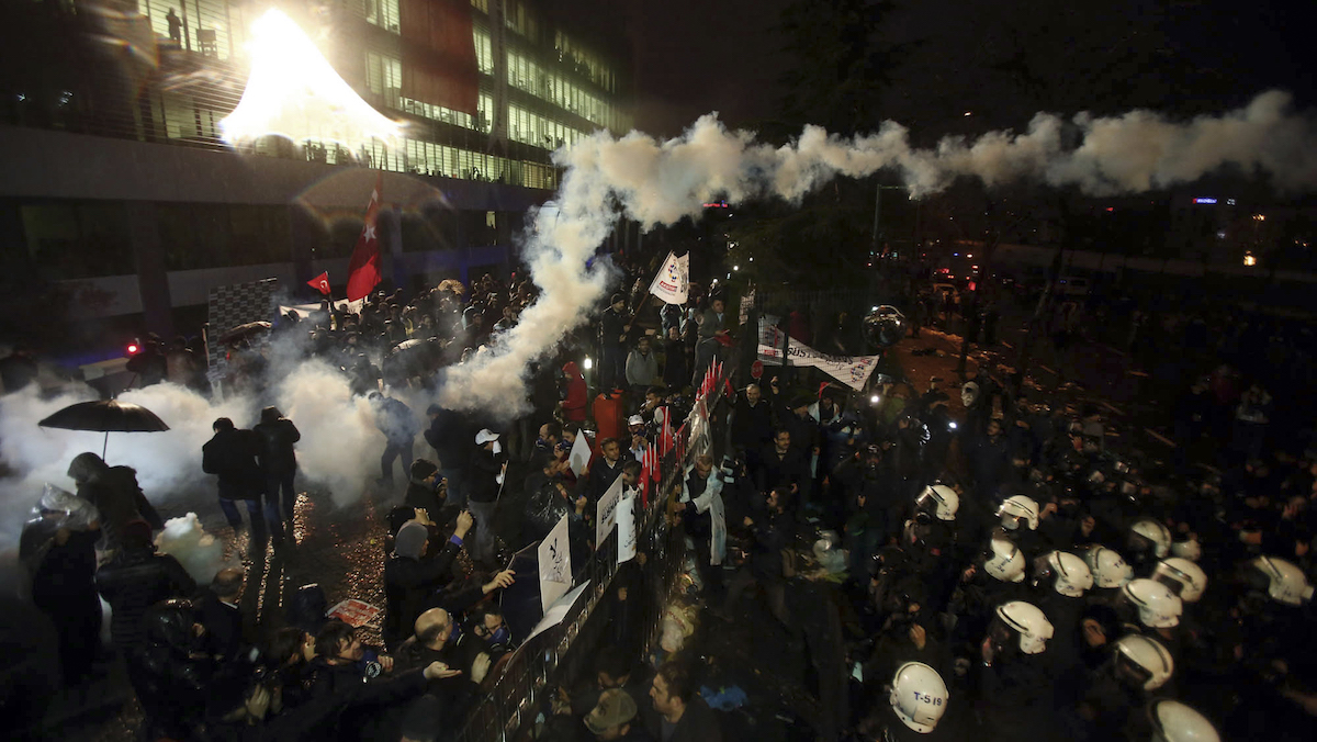 Riot police use teargas and water canon to enter the headquarters of Zaman, in Istanbul, early Saturday, March 5, 2016 after a local court ordered Friday that Turkey's largest-circulation, opposition newspaper, which is linked to a U.S.-based Muslim cleric, be placed under the management of trustees _ a move that heightens concerns over deteriorating press freedoms in Turkey. The move against Zaman newspaper comes as the government has intensified a campaign against the movement led by Fethullah Gulen which it accuses of attempting to topple it.