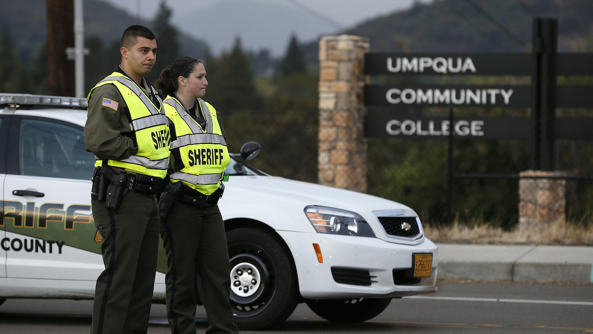 Sheriff's deputies man a roadblock on the road leading to Umpqua Community College Saturday, Oct. 3, 2015, in Roseburg, Ore. Armed with multiple guns, Chris Harper Mercer, 26, walked in a classroom at the community college, Thursday, and opened fire, killing nine people and wounding several others.