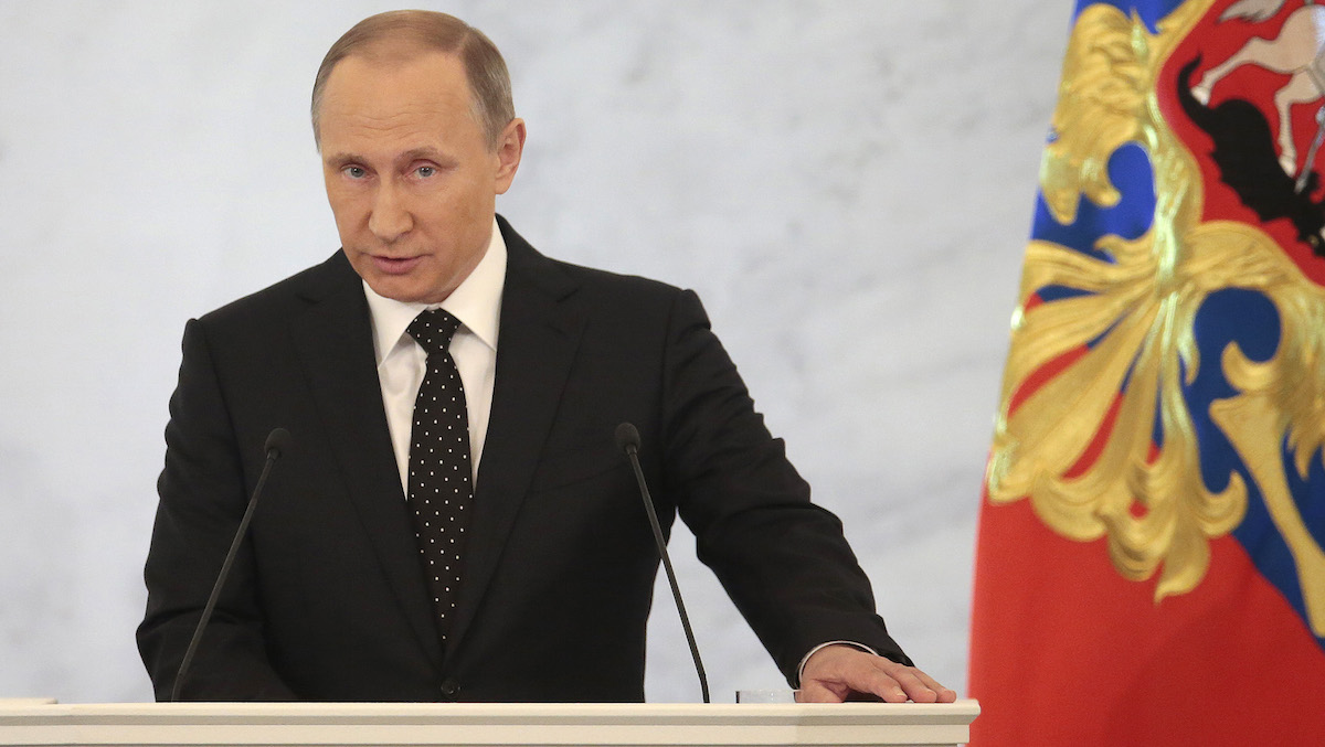 Russian President Vladimir Putin gives his annual state of the nation address in the Kremlin in Moscow, Russia, Thursday, Dec. 3, 2015. Putin says Russian military in Syria has been fighting for Russia's security.