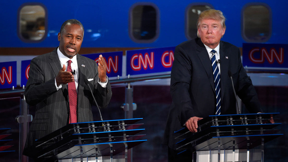 Republican presidential candidate, businessman Donald Trump, right, listens as Ben Carson speaks during the CNN Republican presidential debate at the Ronald Reagan Presidential Library and Museum, Wednesday, Sept. 16, 2015, in Simi Valley, Calif.