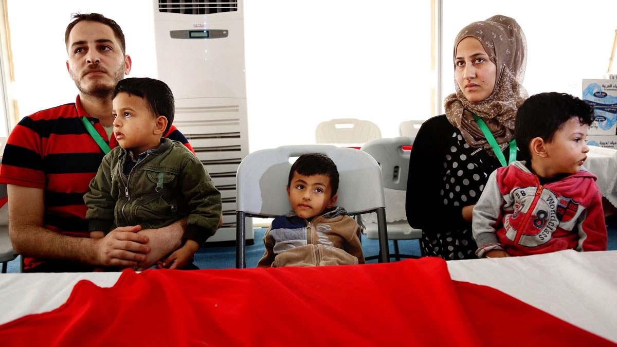 File photo: Syrian refugee children play as they wait with their families to register their names at the U.S. center for refugees during a media tour held by the US embassy in Amman, Jordan, Wednesday, April 6, 2016.