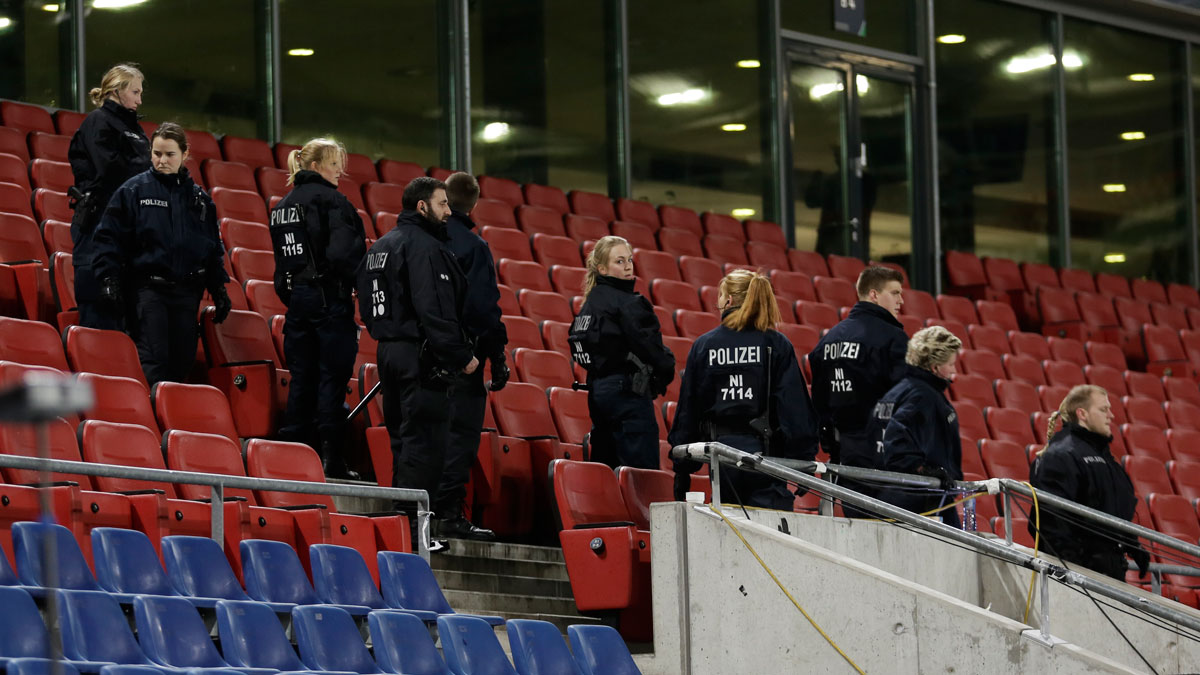 German police officers search between the seats of the stadium prior to an international friendly soccer match between Germany and the Netherlands in Hannover, Germany, Tuesday, Nov. 17, 2015. Following the Friday's  attacks in Paris, security measures have been increased for the match.