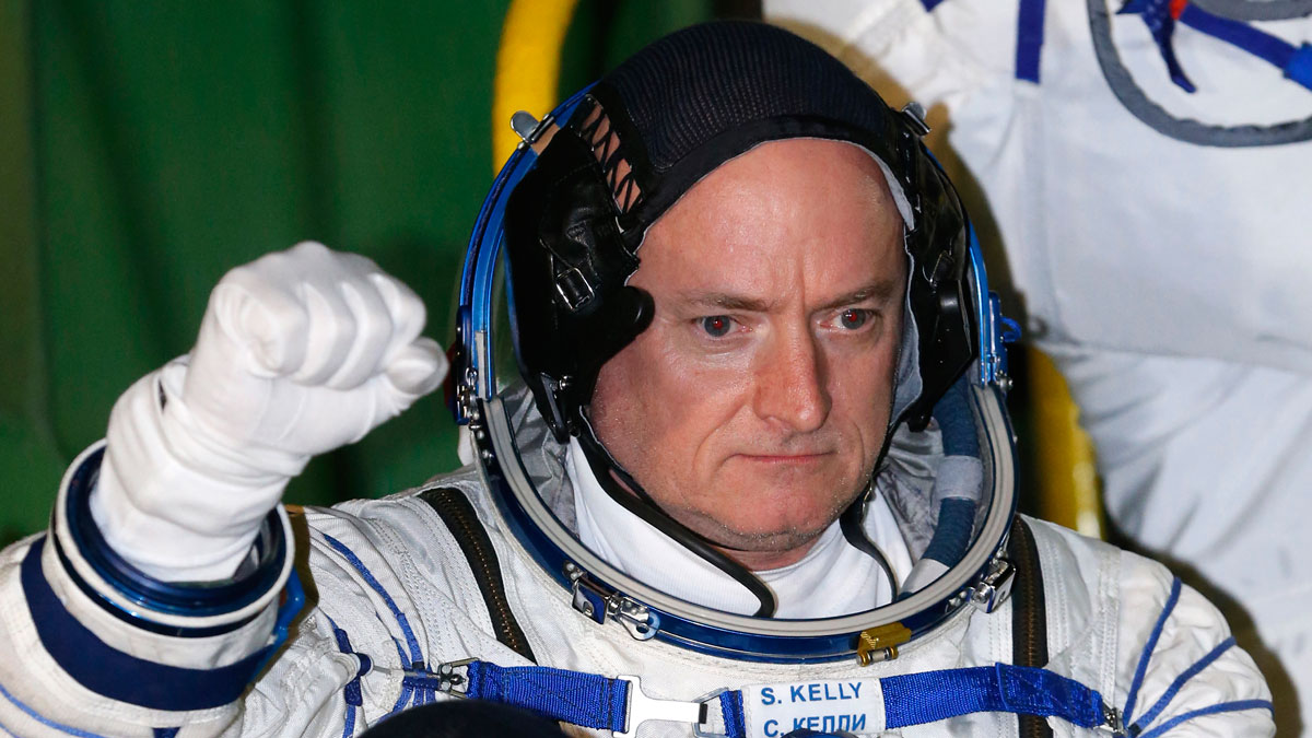 U.S. astronaut Scott Kelly, a crew member of the mission to the International Space Station, ISS, gestures prior to the launch of Soyuz-FG rocket at the Russian leased Baikonur cosmodrome, Kazakhstan, Friday, March 27, 2015.