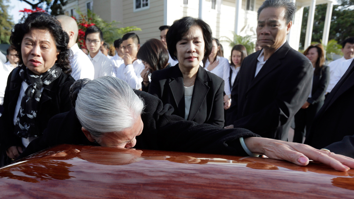 Nghi Van Nguyen, grandmother of Tin Nguyen, weeps over her granddaughter's coffin during the wake at the Peek Funeral home in Westminster, California, on Dec. 11, 2015. Nguyen died in the mass shooting in San Bernardino, Calif., on Dec. 2.
