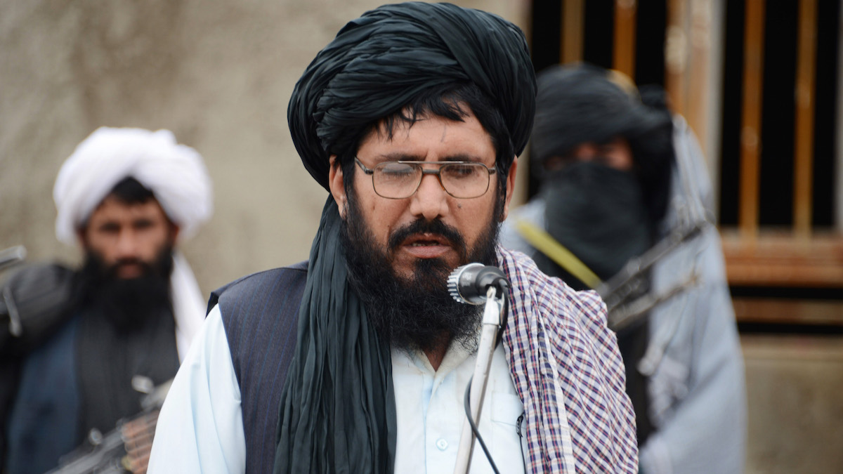 Mullah Mohammed Rasool, the newly-elected leader of a breakaway faction of the Taliban, speaks during a gathering in Farah province, Afghanistan. He was injured in a shooting.