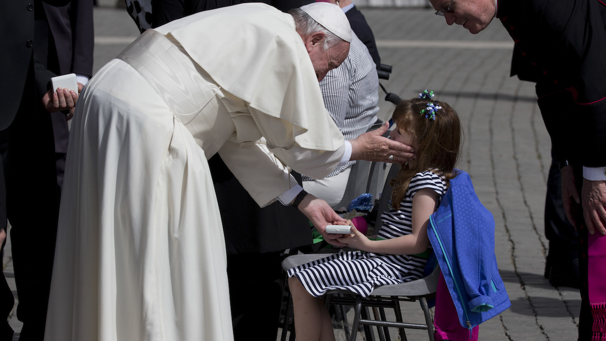 Pope Francis caresses the face of 5-year-old Lizzy Myers, from Bellville, Ohio, at the end of his general audience in St. Peter's Square at the Vatican, Wednesday, April 6, 2016. Lizzy and her family are on a week-long visit to Rome which included a tour of the ancient Colosseum and the hope for a glimpse of Pope Francis.