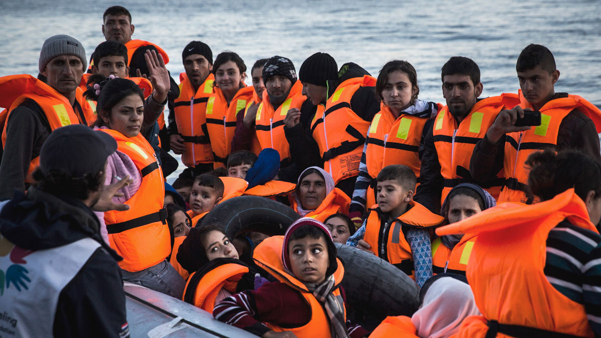 Syrian refugees disembark on the Greek island of Lesbos after crossing the Aegean sea on a dinghy from the Turkish coast, Saturday, Nov. 14, 2015. More than 810,000 people have crossed the Mediterranean this year, and over 200,000 in October alone. Four out of five this year have crossed from Turkey to Greece.