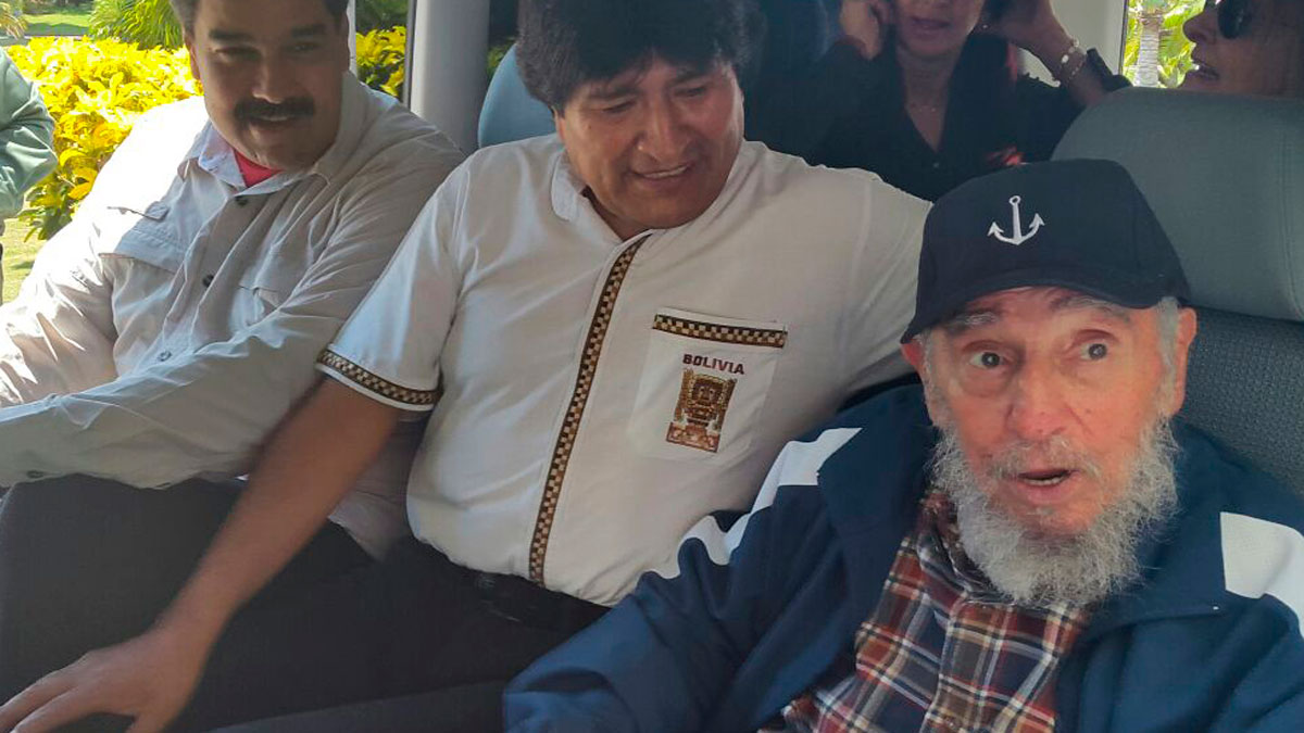 In this photo provided by the Bolivian Information Agency (ABI), Cuba's Fidel Castro, right, Bolivia's President Evo Morales, center, and Venezuela's President Nicolas Maduro sit inside a van after Maduro and Castro picked up Morales at his hotel in Havana, Cuba, Thursday, Aug. 13 2015. Morales and Maduro are in Cuba to celebrate Castro's 89th birthday.