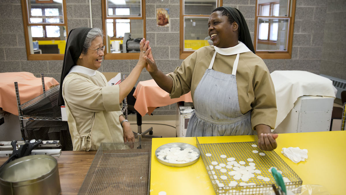 Poor Clares nuns Sister Maria Eden, left, and Sister Thereza share a laugh as they make altar bread also known as communion wafers at the Monastery of Saint Clare in Langhorne, Pa. The nuns are helping to supply wafers for the scheduled Mass being celebrated by Pope Francis on Sept. 27.
